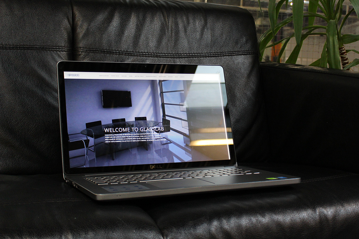 Laptop on sofa at the Sharp Project in Manchester