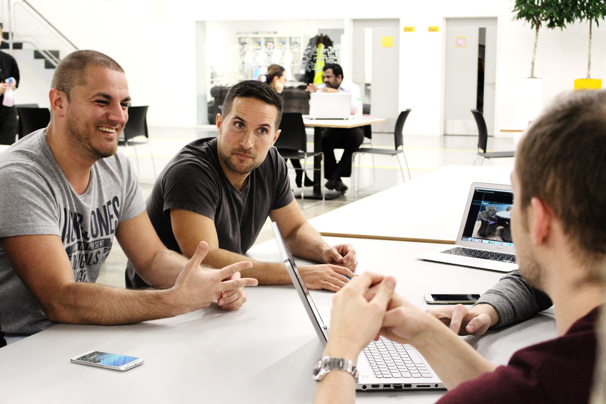 Erik, Chris, Matt and the Pixel Kicks team discussing a website project