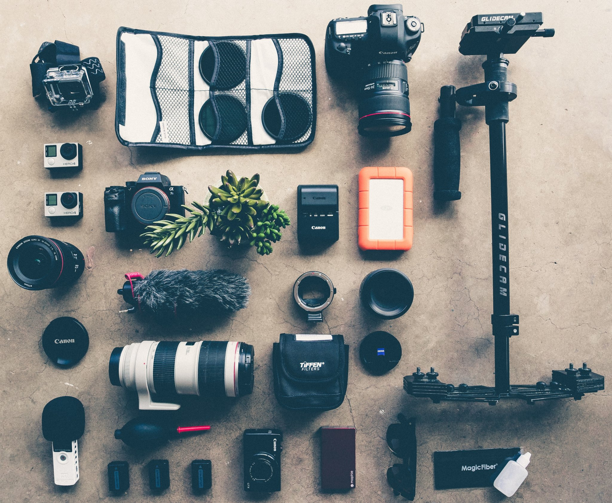 a large flat lay of lots of professional camera equipment