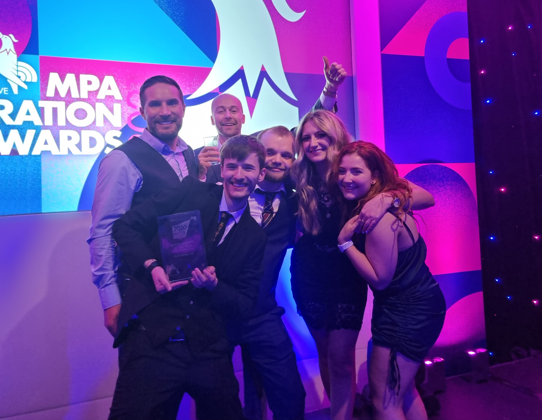 Pixel Kicks at the MPA Awards 2021 - Collecting our award on stage